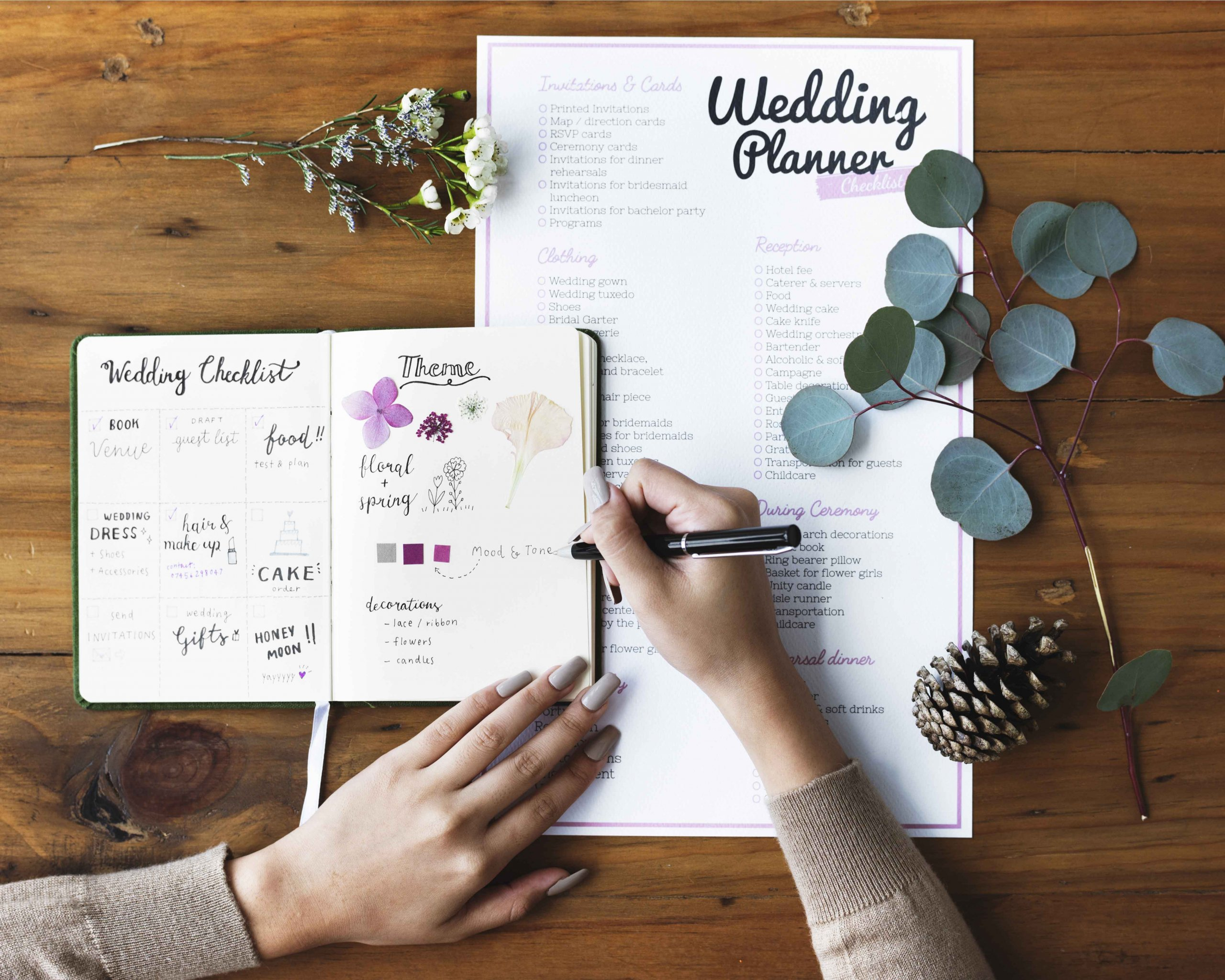 Hands Checking on Wedding Planner Notebook large