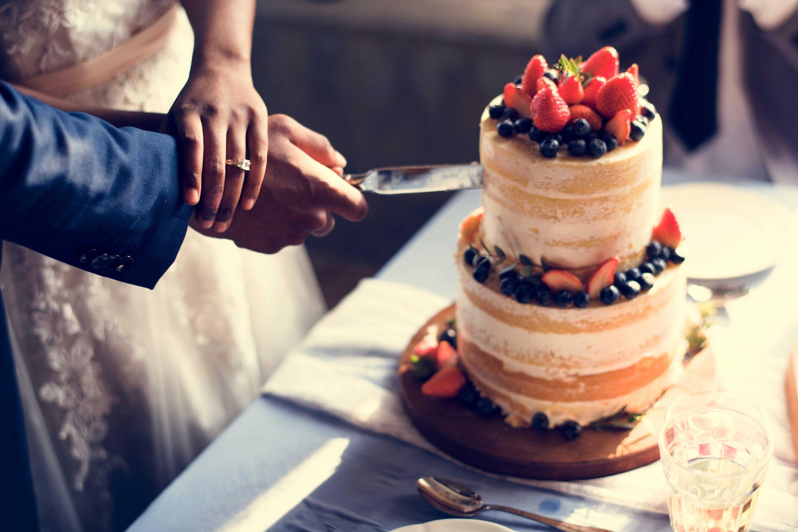 wedding cake couple cut hands togethe for webr