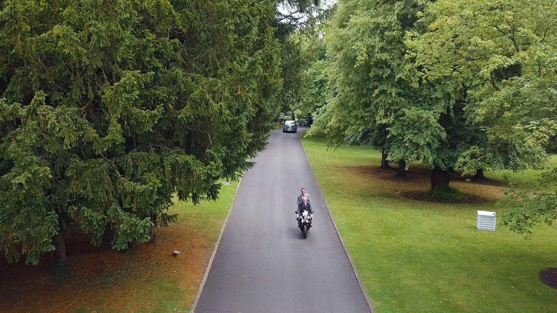 Wedding film aerial motorbike with groom