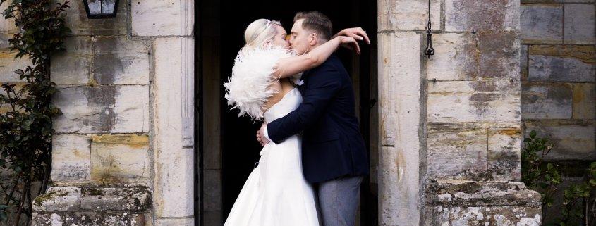 wedding couple kiss doorway
